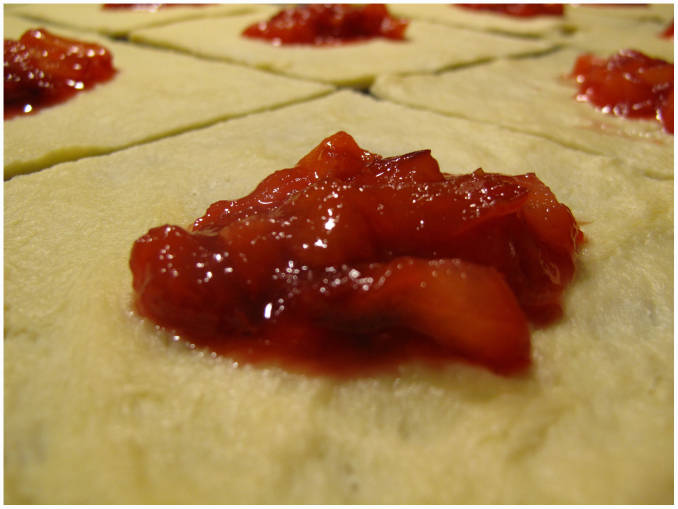 A plum-vanilla filling in danish dough-squares