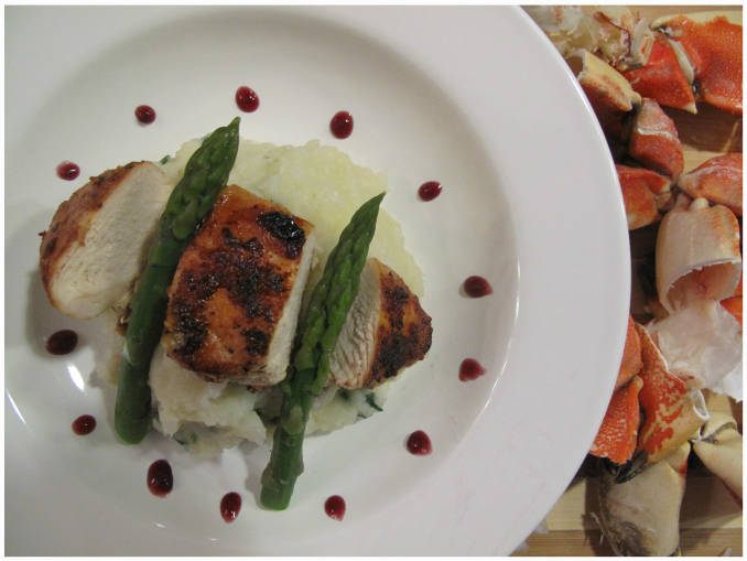 Orange-garlic chicken with crab mashed potatoes, blanched asparagus, and red wine reduction