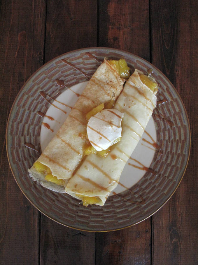 Pineapple-ginger crepes with honey and orange