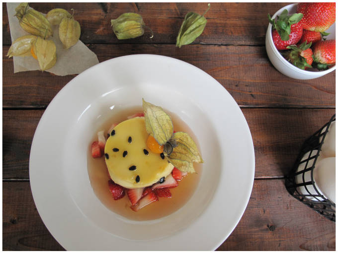 Passion fruit crème caramel with strawberries and a Chinese lantern fruit