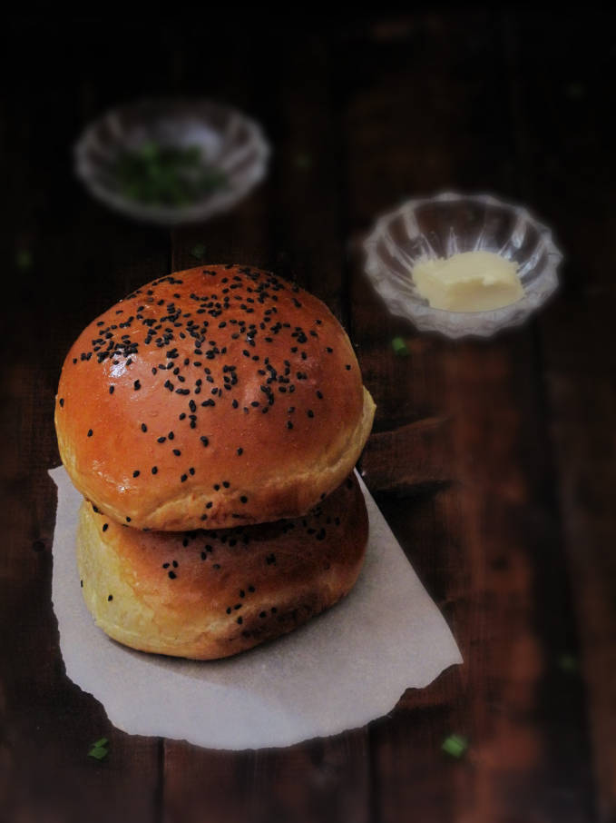 Homemade challah hamburger buns with butter and chives