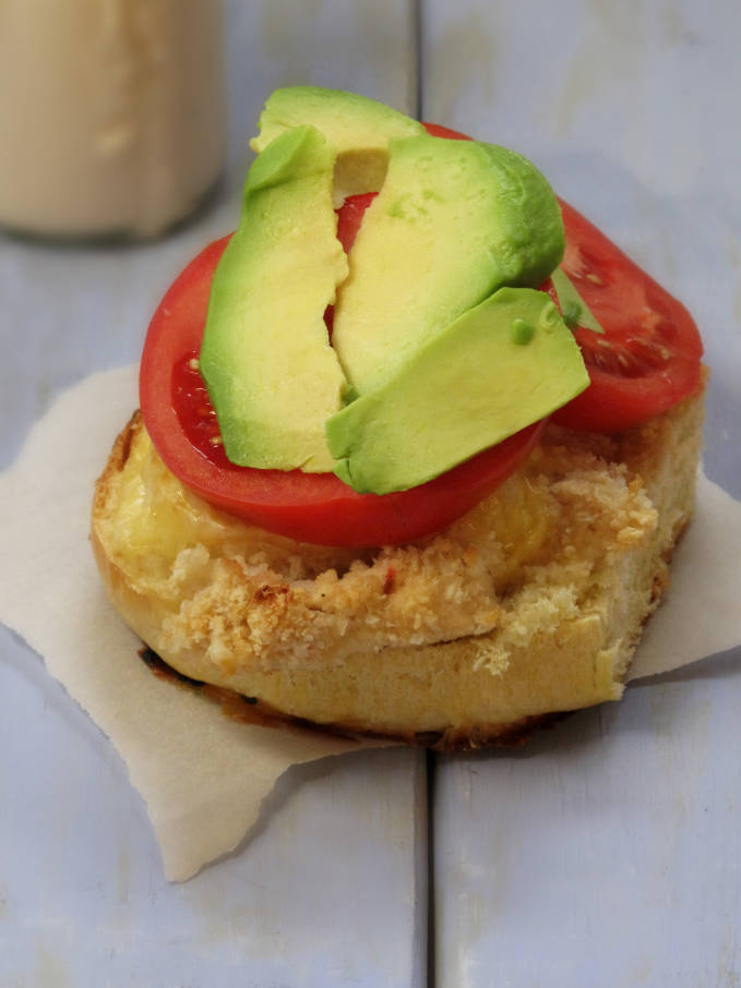 Homemade challah bun with chicken, cheese, tomato, and avocado