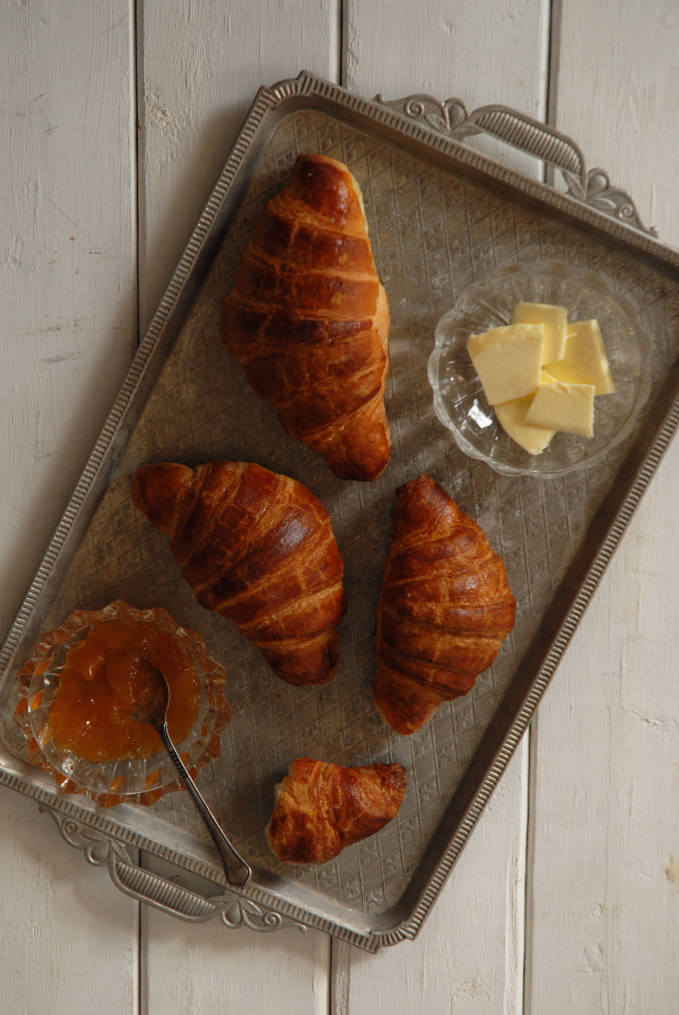 Homemade croissants with apricot jam and butter