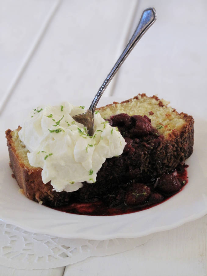 Coconut bread with lime-raspberry compote and freshly whipped cream topped with lime zest