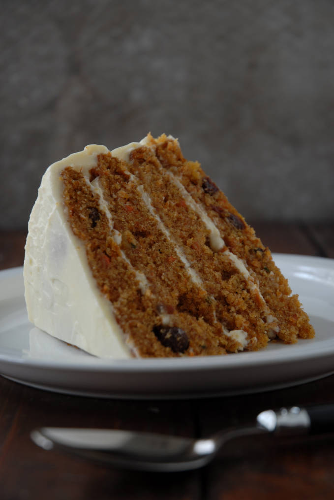 Carrot cake with pineapple chunks and raisins, coated in cream cheese frosting. Folks, this is the BEST CARROT CAKE EVER. Click for the recipe!