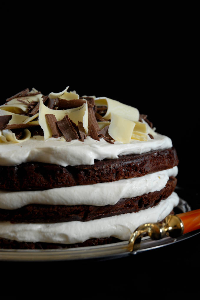 Chocolate cake with spiked whipped cream and chocolate curls. Click for the recipe!