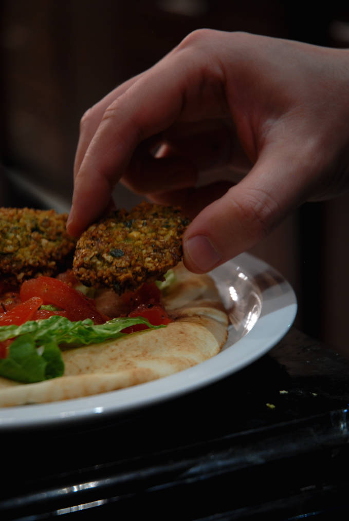 Chickpea falafel on a pita with vegetables. Click for the recipe!