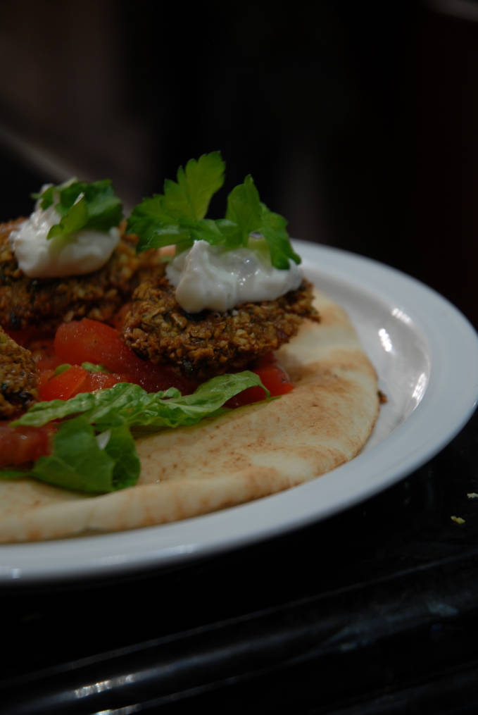 Homemade chickpea falafel on a pita with lettuce, tomato, onion, and tzatziki sauce... click for the recipe!