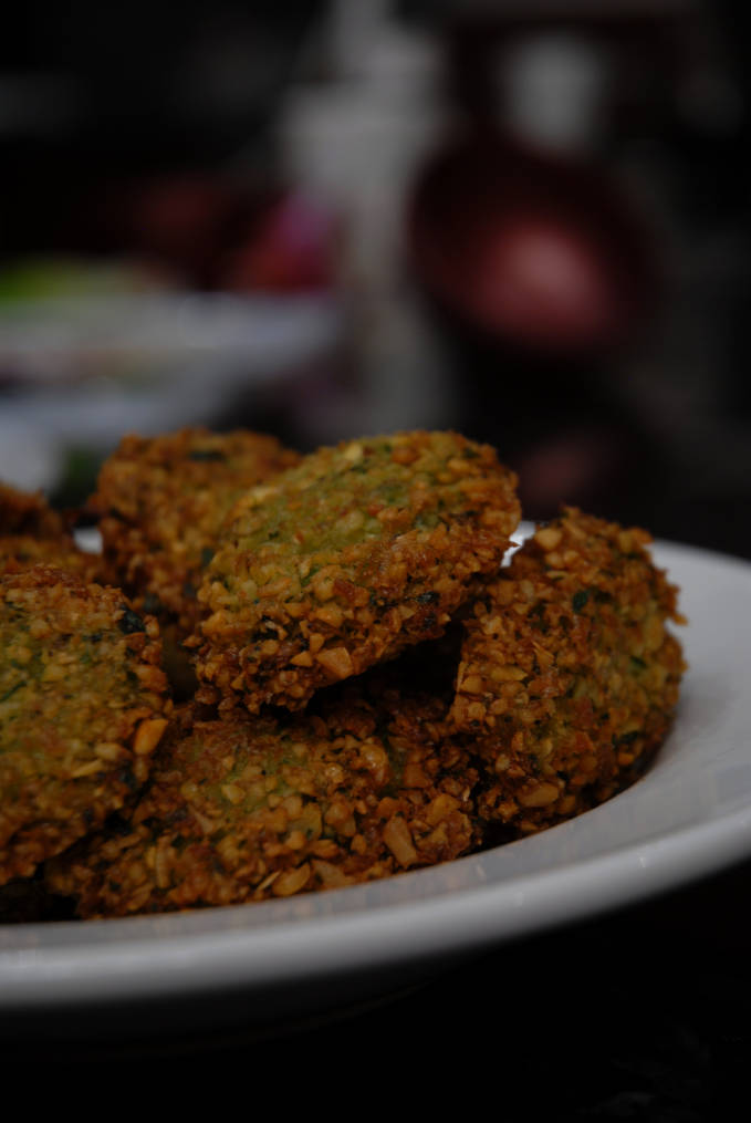 Homemade chickpea falafel with cilantro and parsley. Click for the scrumptious recipe!