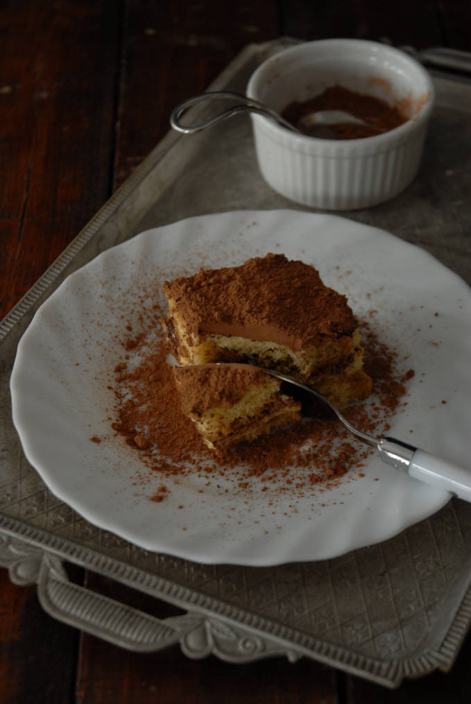 Homemade tiramisu dusted with cocoa powder. Make your own! Click to get the recipe.