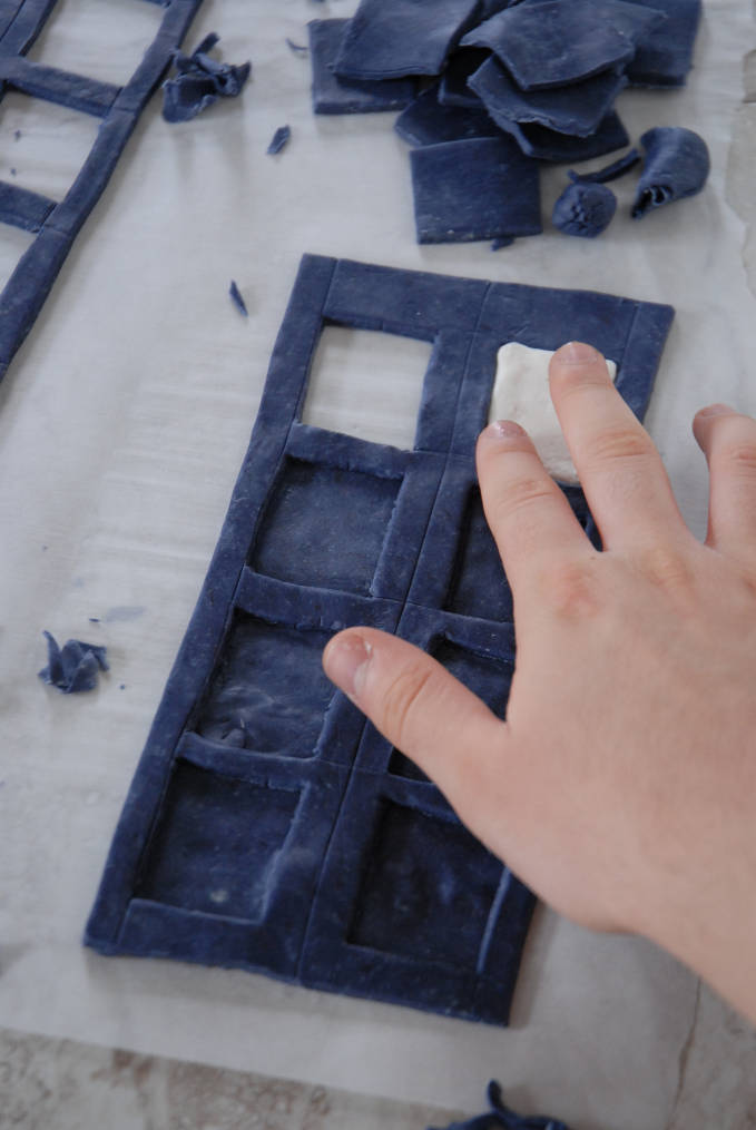 Adding a fondant window to a Doctor Who TARDIS cake--click to see the full photo tutorial so YOU CAN MAKE YOUR OWN DOCTOR WHO TARDIS CAKE! #diy
