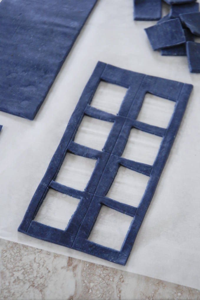 Cutting out panels from TARDIS cake sides--click to see the full photo tutorial so YOU CAN MAKE YOUR OWN DOCTOR WHO TARDIS CAKE! #diy