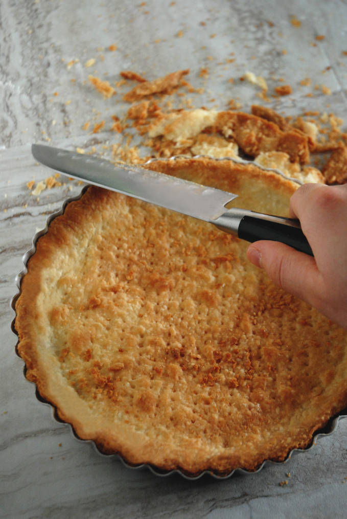 Cutting tart dough with a sharp knife while it's warm helps with straight edges--click to get instructions on how to make PERFECT PIE & TART DOUGH every time!