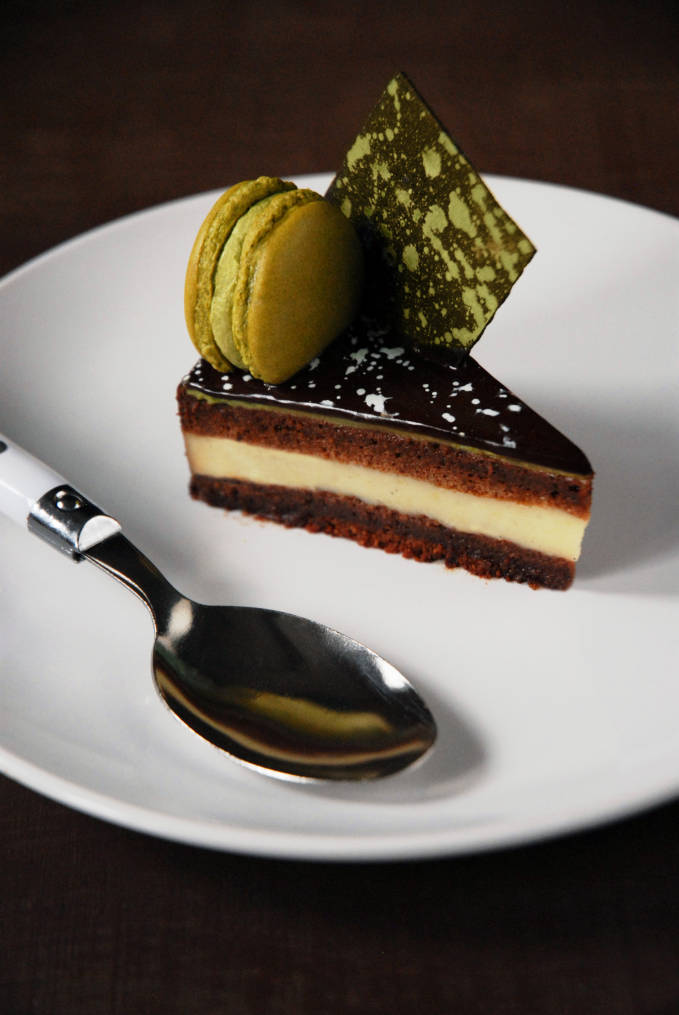 Chocolate and matcha entremet with a chewy dark chocolate brownie layer, vanilla crémeux, chocolate joconde cake, a thin layer of matcha mousse, chocolate mirror glaze, and a matcha macaron. Click for the recipe!