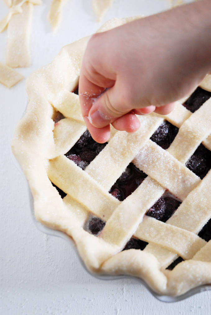 Sprinkling sugar over a pie, along with an egg wash, helps in achieving a golden brown colour--click to get a step-by-step photo tutorial on lattice pie crusts, so you can make them easily!