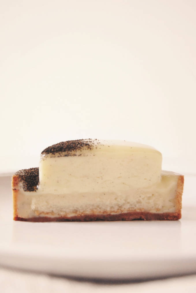 Do you like vanilla? This is a vanilla tart with white chocolate-vanilla ganache, rum-infused lady finger biscuit, vanilla mascarpone cream, and ground vanilla bean garnish!