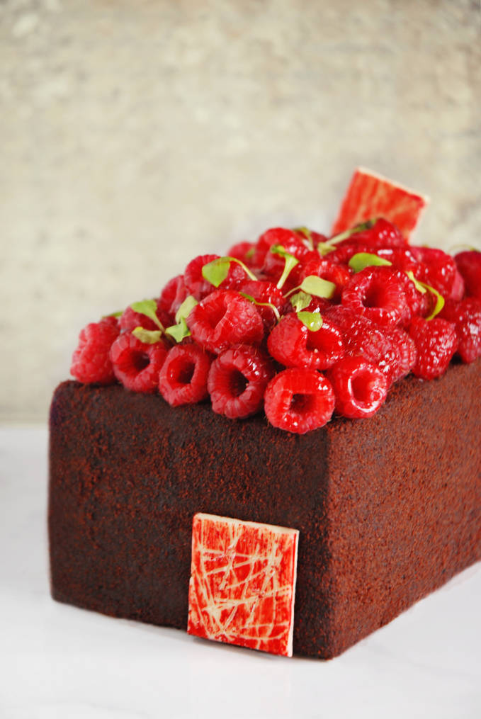 Sinful dark chocolate devil's food cake with raspberries. Click for the AMAZING recipe!