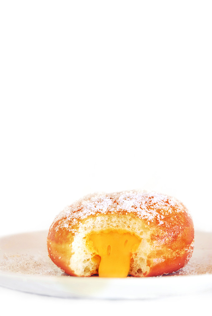 Oozing mango vanilla doughnuts are exceptionally tasty, light, and fluffy! Click to get the recipe.