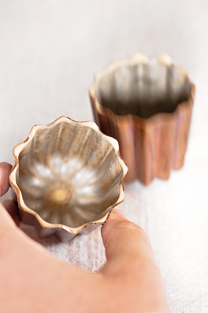 "Copper canelé moulds lightly coated with ""white oil"" beeswax and butter mixture"